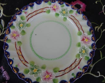 Handpainted Vintage Small plate or saucer from Japan  Signed.  Beautiful embellished flowers and gold trim   Size 6 1/4 inches