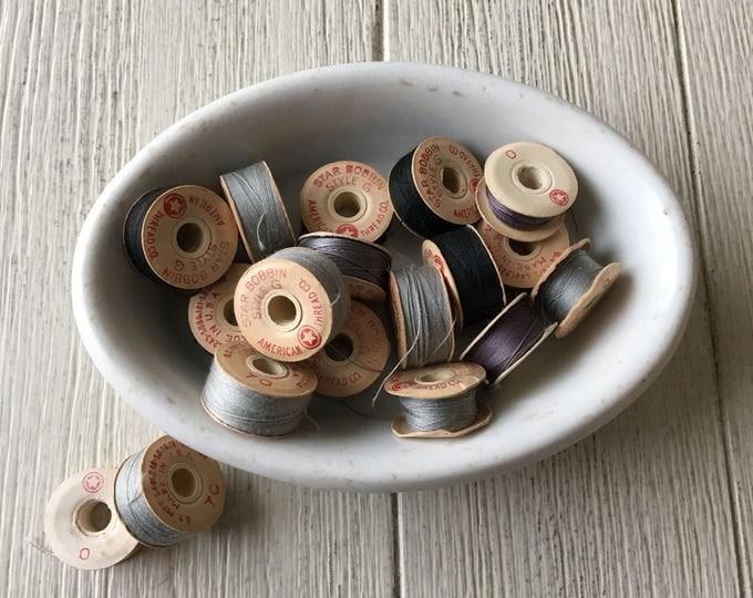 Vintage Bobbins Pewter Gray Black Thread Star 18 Spools
