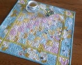 Spring Promenade 24 inch quilted table centerpiece in bright spring colors of yellow, orchid and robins egg blue