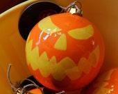 "Jack-o'-lantern Ceramic Ball Ornament 4"" in Orange and Yellow"