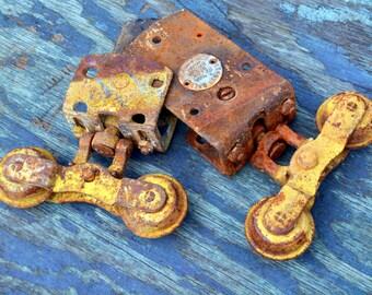 Vintage Rustic Barn Door Sliders / Hangers: Matching Pair of 2 Industrial CANNONBALL Double Wheel Barn Hardware - Steel Yellow Chippy Paint