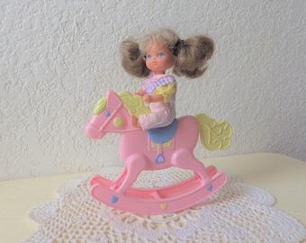 Heart Family Baby Doll riding Heart Family Rocking Horse, 1980s