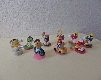 Nine Sports Related M & M Topper Collectibles,