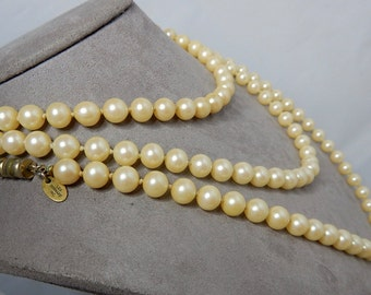 LES BERNARD Signed Extra Long Single Strand Knotted Pearl Necklace    NDW21