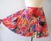 80s tennis skirt - vintage bright neon loud multicolor rainbow geometric abstract pleated mini athletic athleisure Lily's Beverly Hills