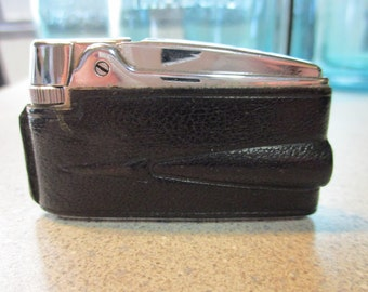 1960's Ronson black leather tail light lighter Made In England