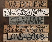 In this HOUSE Sign ASSEMBLED We Believe Black Lives Matter Love is Love Kindness is Everything on 7 boards