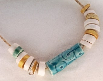 The clear body of spring -- a set of 16 white, green, turquoise, gold ceramic art beads