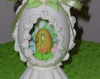 Easter Egg - Panoramic Sugar Egg White Egg within an Egg with Easter Decor, Eggs and Flowers