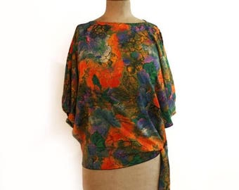 ON SALE Vintage original 1970s bright orange teal and black floral batwing top with side tie
