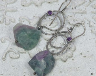 Rough fluorite stones hanging from silver scribbles