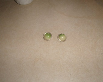 vintage clip on earrings goldtone lucite green swirl