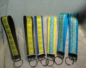 Fun Jacquard Woven Print Ribbon Key Fobs in different in Yellow or Blue