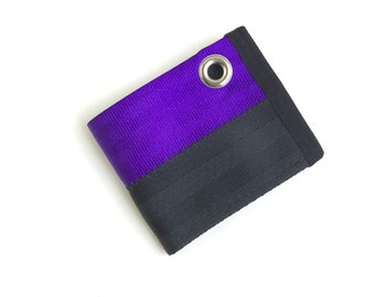Purple and black wallet with grommet