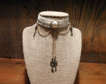 white ribbon necklace with antique steampunk looking embellishments