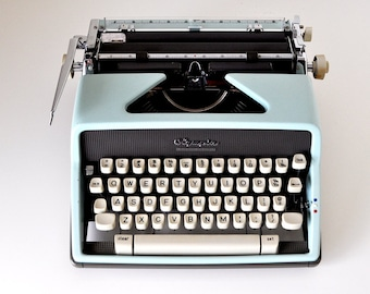 Vintage 1963 Blue Olympia DeLuxe SM7 Manual Typewriter West Germany
