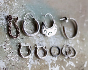 Assorted Collection of Single Hoop Earrings in Sterling Silver - set of 9