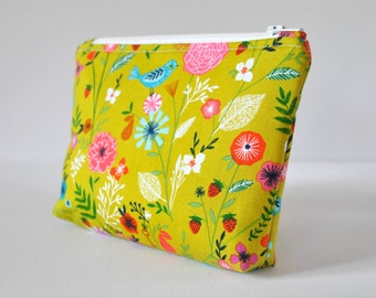 Woman's cosmetics make up bag olive green bird and flower travel beauty padded pouch floral birds wildlife print in pink, blue and red.