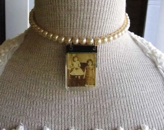 Pearl , upcycled, vintage necklace with old fuse box pendant.