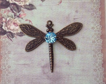 1 Antique brass dragonfly with a Swarovski crystal stone, in Aquamarine.