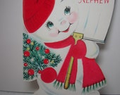 Unused 1950's-60's die cut red flocked Norcross christmas card to nephew,snowboy carries shovel and mini christmas tree,wears red hat ,scarf