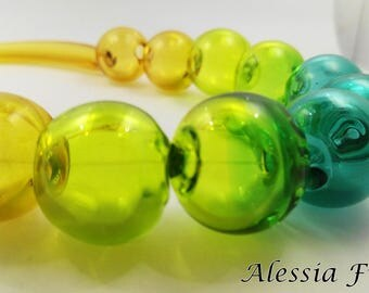 Blown glass beads necklace in shades of topaz and green