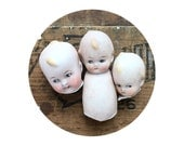 3 vintage antique doll heads and bodies, doll parts, dug up, frozen charlotte, kewpie doll, googly