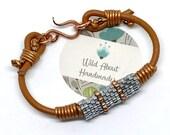 Reserved, Leather Cord and Silver Lined Bracelet Peyote Weave Brick Stitch Cylinder Bracelet