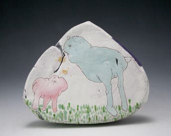 Handmade Triangle Shaped Ceramic Object with Two Creatures Drawn Breathing at One Another
