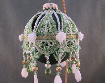 green lace covered beaded ornament with Swarovski beads