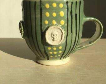 Handmade wheel thrown ceramic Mug with Skull accents