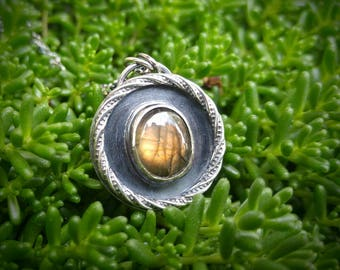"Labradorite and Sterling Silver Necklace. Round Pendant with Golden Yellow Flash Stone & Twist Wire. On the Reverse 'glow' on 18"" chain"