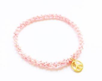 Golden peace charm stackable beaded crochet peachy coral blush pink yoga friendship bracelet