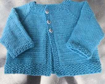 Hand knit bright turquoise baby girl cardigan
