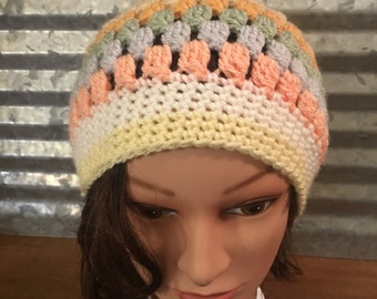 Muted colors crocheted hat with furry pom pom