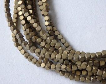 Teeny tiny MATTE GOLD hematite cube beads - strand of 2mm golden brass tone hematite, 2mm rounded cube beads, small matte hematite beads