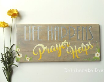 """12 inch long """"Life happens prayer helps"""" solid wood sign in gray stained wood and yellow  ombre toned letters with flower accents"""
