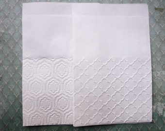 """10 white  paper bags embossed  5,11"""" x 6,88""""  ( made in Germany)"""
