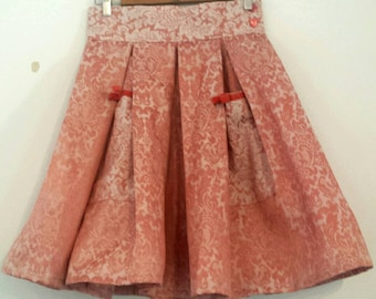 Cute blush pink brocade pleated skirt. Vintage fabric with velvet trim pepping pockets. Waist 30 length 23.