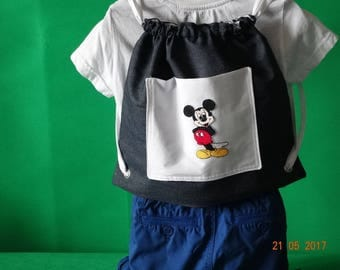 Boys or girls rucksack with Mickey Mouse embriodered pocket.