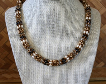 Elegant beaded necklace featuring dark and light bronze with cream and crystal accents
