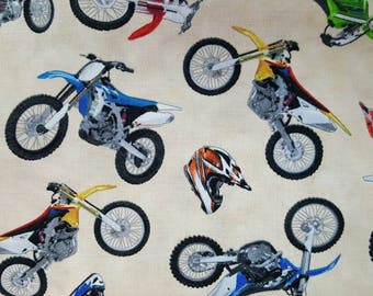 "100% cotton Quilting fabric the motocross 1/2 yard dirt bike  motorcycles  cream background .   Bikes about 3.25""  available in black too"