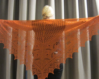 Orange handknitted estonian lace and nupps shawl