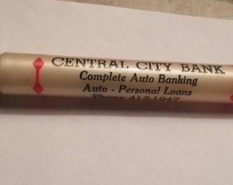 Vintage bottle/can opener. Bakelite/plastic?. Central City Bank.