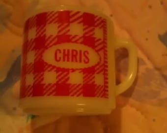 Westfield milk glass mug. Chris is name. Red/white check pattern.