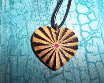 """Hand Crafted """"Rayed Heart"""" in Birch wood with  Red Zircon center, Pendant ."""