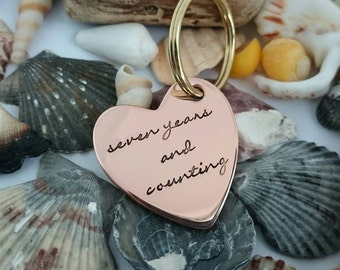 seven years and counting hand stamped sateen finish copper heart keyring wedding anniversary