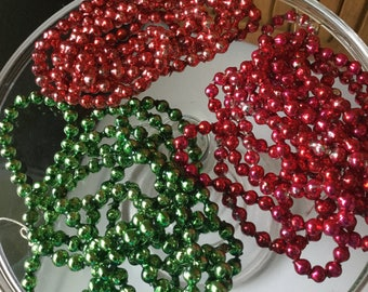 Choice of one vintage Mercury glass bead strand in red, green, Pinkish/red