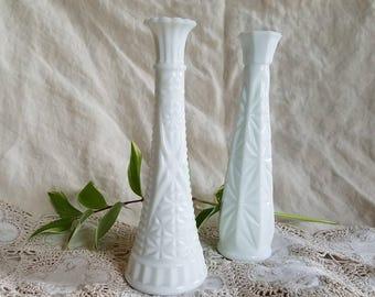 Two mismatched milkglass bud vases