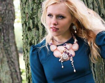 Volumetric handmade necklace with amethyst, pink quartz, pearls, rhodochrosite and shells